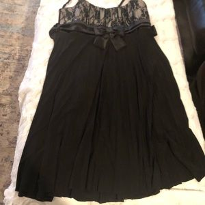 Black lace top dress with flowing bottom.